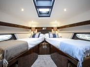 53-interior-master-cabin-beds-open-1200x862